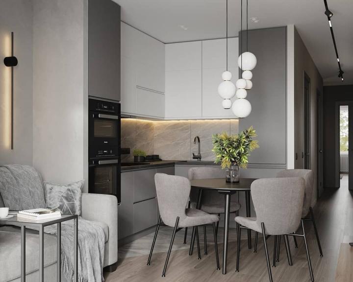 Спокойный серый интерьер кухни-гостиной